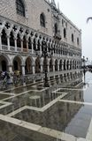 Doges Palace Piazzetta Venice. The side wall of the Doges Palace in Piazzetta, Venice, Italy. The palace is reflected on the waters that flooded the piazza with royalty free stock photography