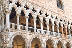 Doges Palace at St Mark Square in Venice, Italy. Wall of the Doge`s Palace diagonally with tiles, columns and arches at St Mark Square in Venice, Italy Stock Image