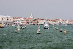 Doges palace and water traffic in summer Venice Stock Photo