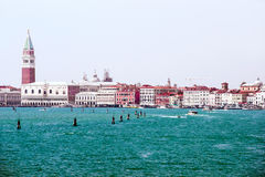 Doges palace and water traffic in summer Venice Stock Photography