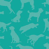 Doggie Style. A seamless pattern comprised of dog silhouettes, over a solid teal color background Stock Images