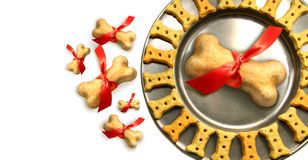 Doggy biscuits for christmas against white Royalty Free Stock Photo