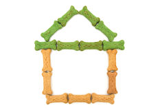 Doghouse. Dog treats in the shape of a house isolated on a white background, doghouse Royalty Free Stock Photo