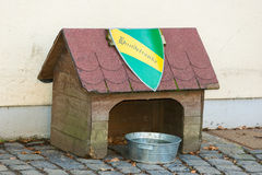 Doghouse and a drinking bowl. Doghouse with a metal drinking bowl Royalty Free Stock Images