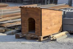 Doghouse made at the factory. House for a dog. Doghouse made at the factory. House for a dog Royalty Free Stock Photography
