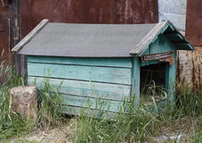 Doghouse. An old green wooden doghouse outdoors Stock Photo