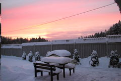 Doghouse and winter sunset. Royalty Free Stock Photos
