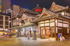 Dogo Onsen. MATSUYAMA, JAPAN - DECEMBER 3, 2012: Tourists at Dogo Onsen bath house. It is one of the oldest bath houses in the country stock photography