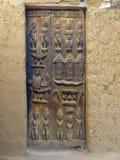 Dogon door. Door, entry, home, dogon, inlays, wood, animals, sacred idols, animist religion Royalty Free Stock Photo