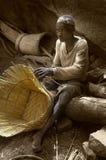 Dogon village, Dogon land, Tireli, Mali, Africa. Tireli, Mali, Africa - January 30, 1992: Dogon village and typical mud buildings, artisans make wicker baskets Royalty Free Stock Photography
