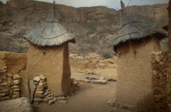 Dogon village, Dogon land, Tireli, Mali, Africa. Tireli, Mali, Africa - January 30, 1992: Dogon village and typical mud buildings, buildings used as barns for Stock Photography