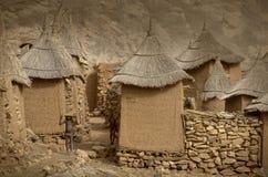 Dogon village, Dogon land, Tireli, Mali, Africa. Tireli, Mali, Africa - January 30, 1992: Dogon village and typical mud buildings, buildings used as barns for Stock Photo