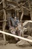 Dogon village, Dogon land, Tireli, Mali, Africa. Tireli, Mali, Africa - January 30, 1992: Dogon village and typical mud buildings, the frame work hand Stock Photos