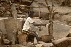 Dogon village, Dogon land, Tireli, Mali, Africa. Tireli, Mali, Africa - January 30, 1992: Dogon village and typical mud buildings, the frame work hand Royalty Free Stock Photos