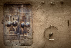 Dogon village, Dogon land, Tireli, Mali, Africa. Tireli, Mali, Africa - January 30, 1992: Dogon village and typical mud buildings, typical handmade window on Stock Photos