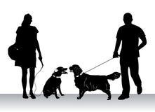 dogs att gå för folk Royaltyfri Bild
