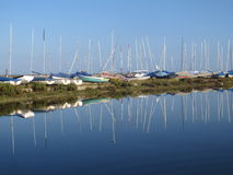 Boats sea sky blue reflection. Norfolk boats sea sky beach sailing sun. UK british Stock Image
