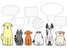 Dogs and cats in a row with speech bubbles Stock Photography