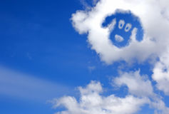 Dogs face in the sky clouds Stock Photo