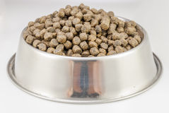Dogs food. Brown dogs food in bowl on white background stock image