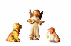 Dogs and little angel figure Stock Image
