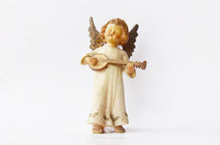 Dogs and little angel figure Stock Photography