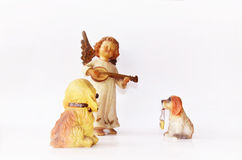 Dogs and little angel figure Royalty Free Stock Photography