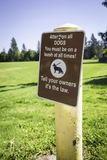 Dogs Must Be On Leashes Sign. A sign stating that all pets must be on their leashes at all times Royalty Free Stock Photo