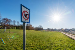 Dogs not Allowed sign before a playground Royalty Free Stock Photos