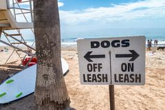 Free Dogs On And Off Leash Sign On The Beach Stock Photography - 101302892