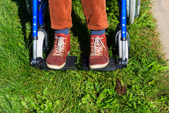 Dogs poop problem for person on wheelchair. Unpleasant and disgusting Royalty Free Stock Photography