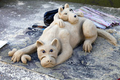 Dogs sand sculpture street art. Two dogs sand sculpture street art Royalty Free Stock Photo