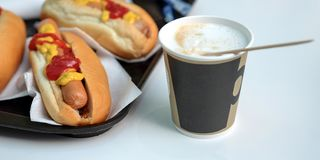 The-dogs, sauce, ketchup, coffee with milk in a Cup. Latte stock image
