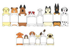 Dogs standing with the card. Various breeds of cute dogs sitting up with a card Royalty Free Stock Image