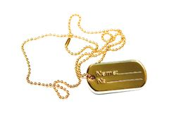 Dogtag d'or Photographie stock libre de droits