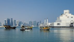 Doha bay dhows towers and islamic art museum Stock Images
