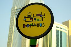 Doha bus sign (Qatar). Bus stop sign in English and Arabic in Doha, the capital of Qatar Royalty Free Stock Image