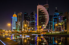 Doha city, Qatar at night. The skyline of the modern and high-rising city of Doha in Qatar, Middle East Stock Photo