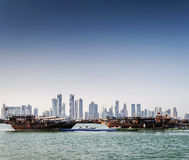 Doha city urban skyline view and dhow boat in qatar Stock Image