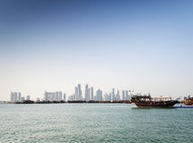 Doha city urban skyline view and dhow boat in qatar Stock Images