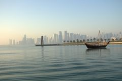 Doha Corniche  Sea side. Doha Corniche sea side .boat view palm trees and buildings landscape Royalty Free Stock Images