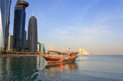 Doha dhow and towers Stock Images