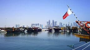 Doha dhows and skyline Royalty Free Stock Photos