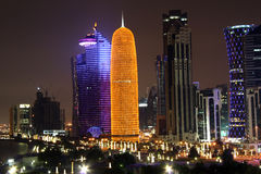 Doha financial and administrative district at nigh. Skyscrapers in the financial and administrative district of Doha, the capital city of Qatar; at night Stock Photography
