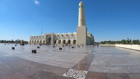 Doha Grand Mosque. State Grand Mosque with a minaret reflecting on marble pavement outdoors. Doha mosque in Downtown, Qatar, Middle East, Arabian Peninsula stock video footage