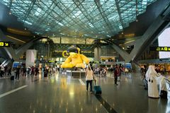 Doha Hamad International Airport, Qatar. Doha, Qatar - June 2017 : Doha Hamad International Airport, Qatar, the main hall area at the international airport of royalty free stock images