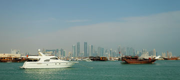 Doha harbour and skyline stock images
