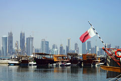 Doha harbour and towers Stock Images