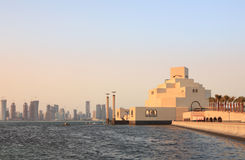 Doha museum and skylne. The Museum of Islamic Art in Doha, Qatar, at sunset with the emerging high-rise skyline behind it, photographed in November 2008 Royalty Free Stock Photos