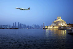 Doha qatar. A qatar airlines flight on the sky of doha capital city of the qatar state stock images